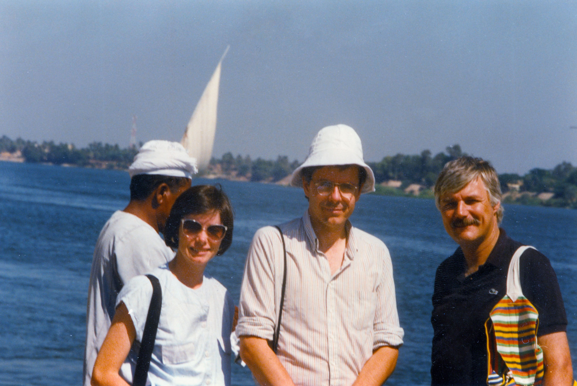 Reville and colleagues standing in sun in front of water