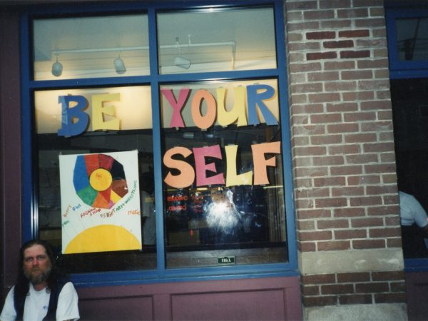 "Exterior view of PARC window with ""Be Yourself"" written in brightly coloured letters."
