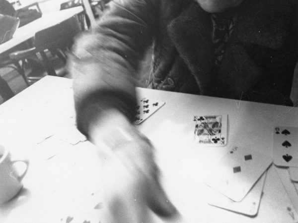 Older woman playing cards at PARC Drop-In
