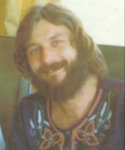 "Reville with beard, long hair and embroidered ""peasant"" shirt"