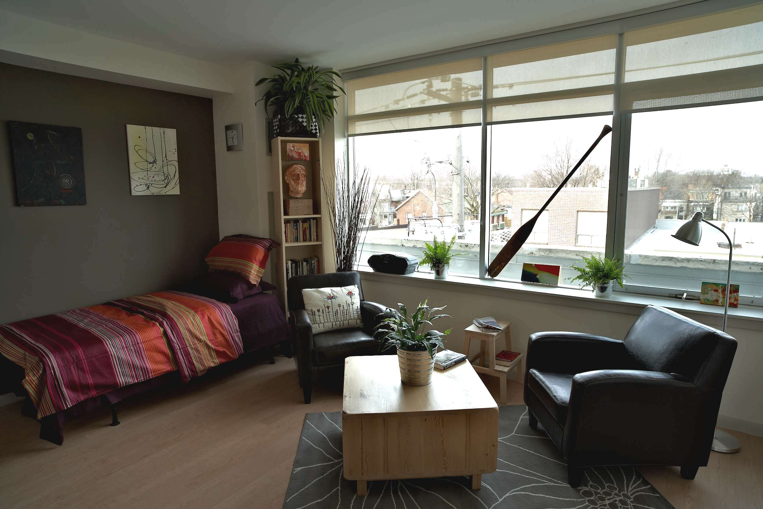 Interior view of apartment in Edmond Place showing bed and living area. This looks like a nice place to live.