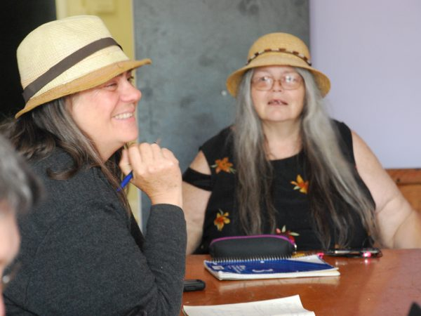Two women, Lahay and Swainson, sitting at writing table.