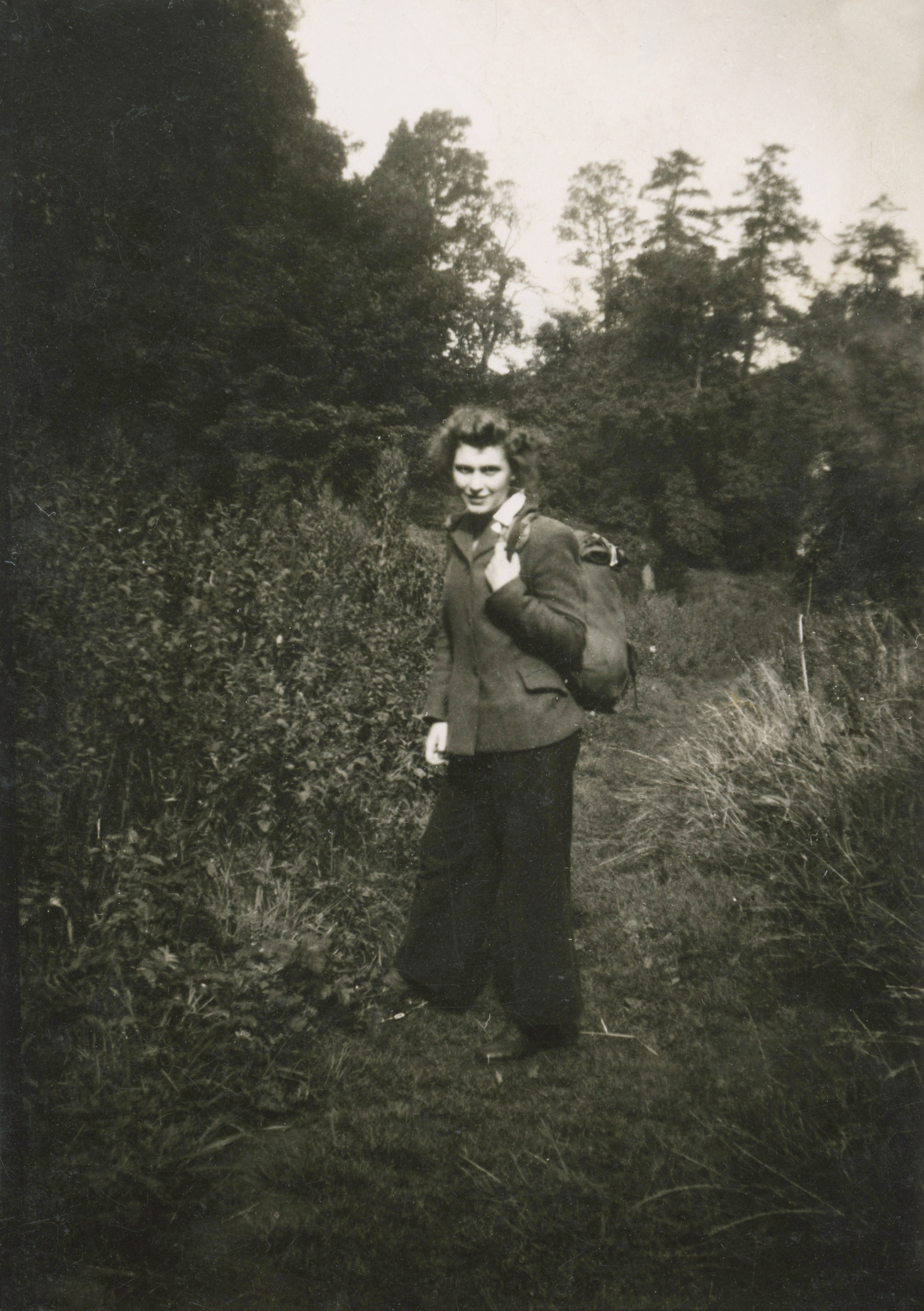 Full figure photograph of Sheila as a young woman heading off for a hike in England