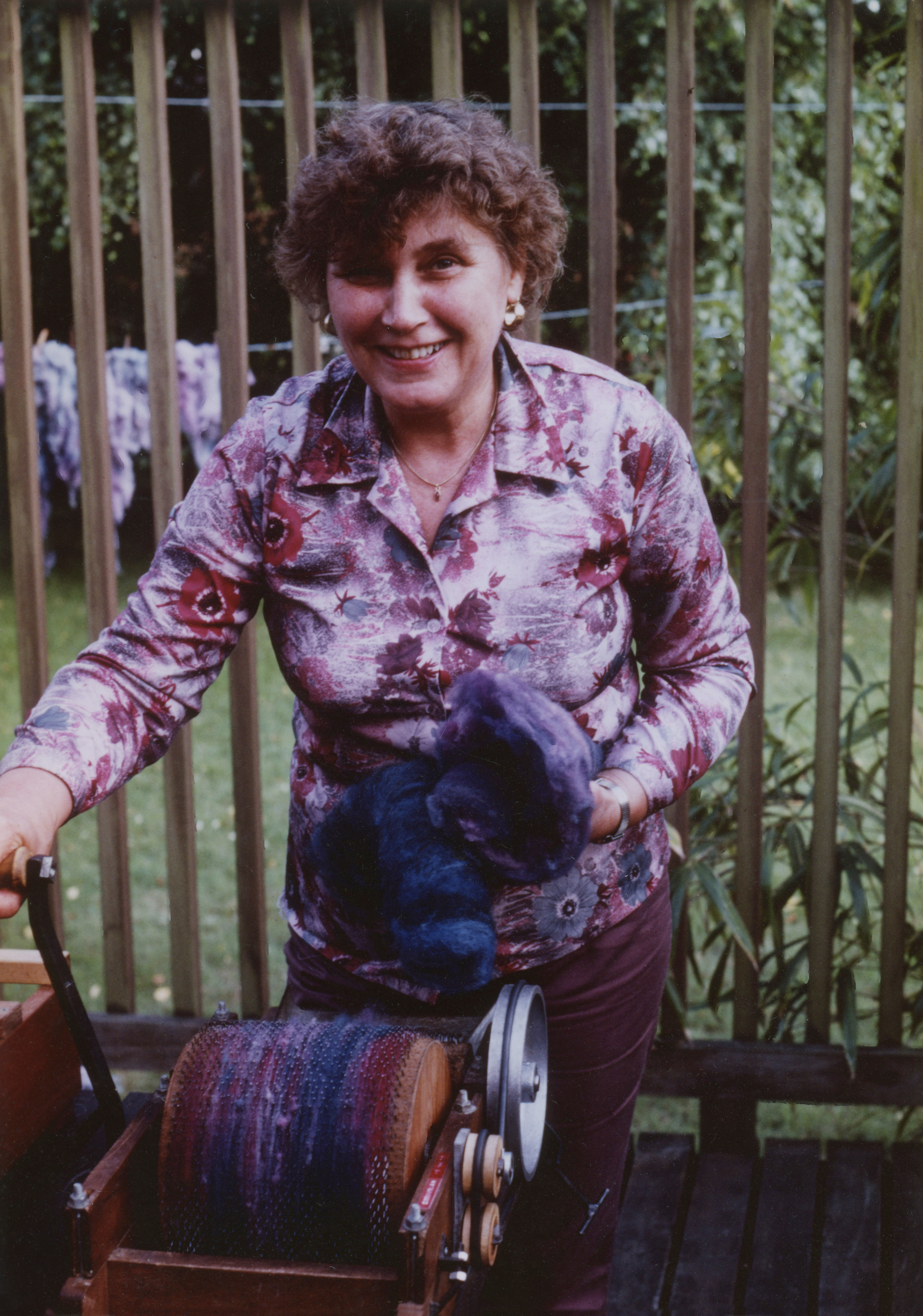 Sheila at home, happily engaged in hand-spinning wool