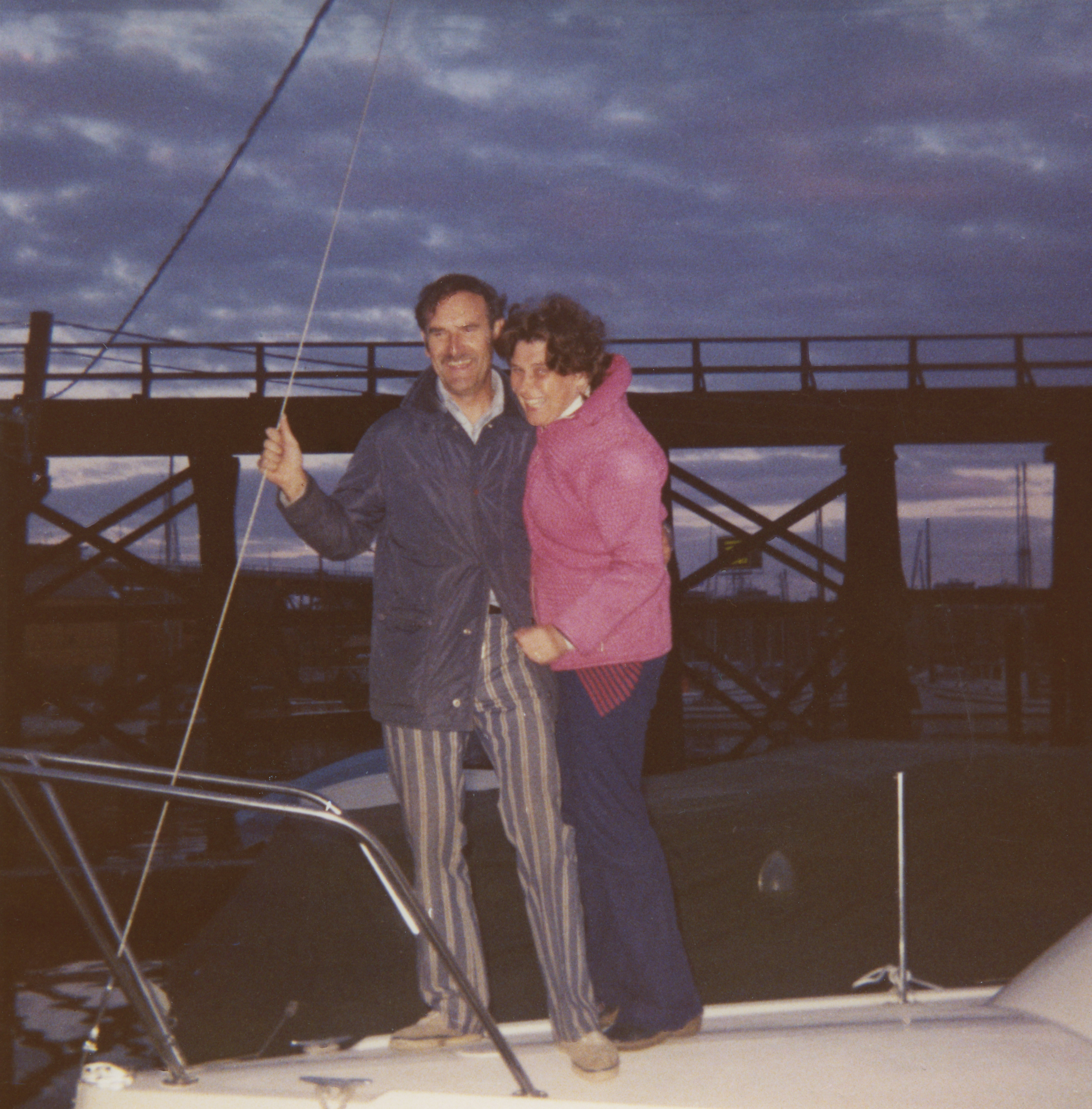 Photograph of Sheila and John laughing and posing together of their boat