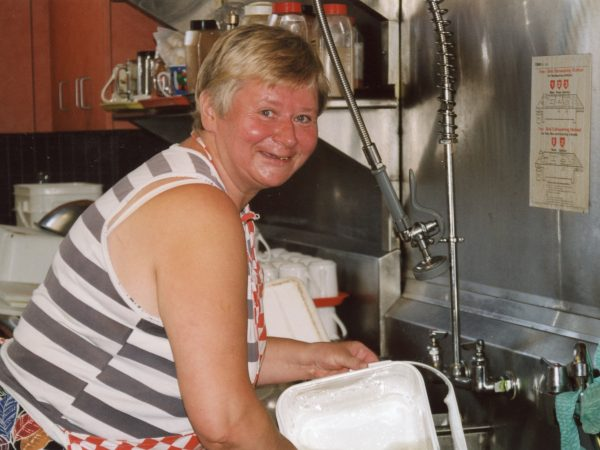 photo of woman at the sink at PARC doing dishes
