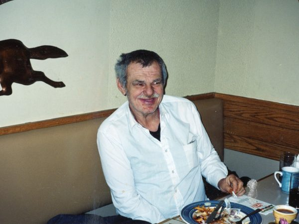 Photo of man at table at PARC eating meal