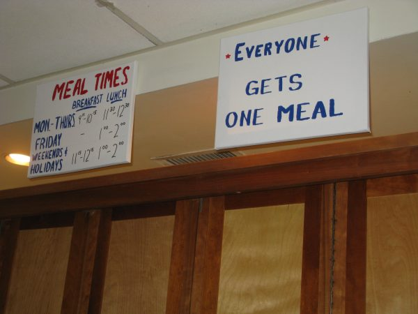 "Photo of food signs at PARC - ""Meal Times"" and ""Everyone Gets One Meal"""