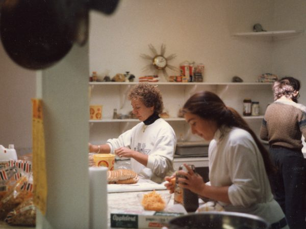 Photo of three women in the kitchen at PARC prepping food