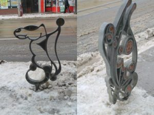 Winter photos of whimsical iron bike stand outside the front of PARC