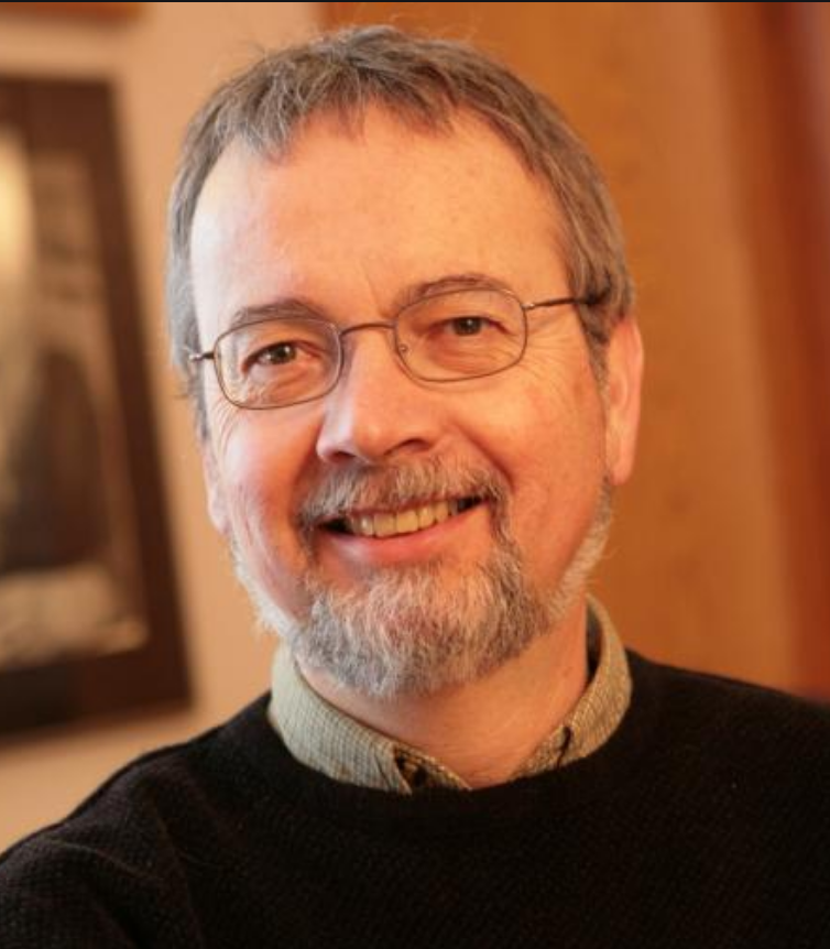 middle aged man with beard and glasses